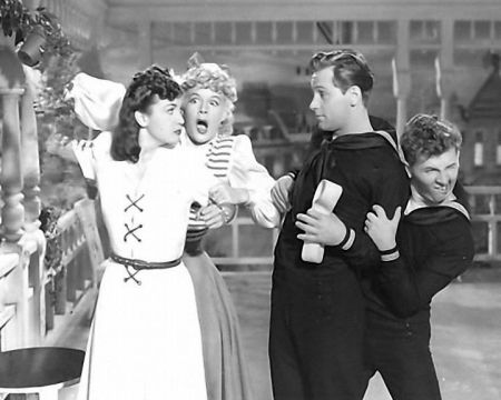 Bessie (Hutton) holds back the Countess (Lamour) when she finds out there is a bet if Casey (Holden) kisses her. Barney (Bracken) hides.
