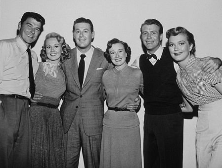 Cast photo of Ronald Reagan, Virginia Mayo, Don DeFore, Phyllis Thaxter, Gene Nelson, Patrice Wymore
