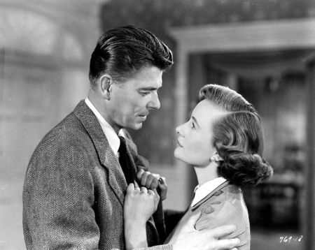"Ronald Reagan and Phyllis Thaxter play husband and wife in ""She's Working Her Way Through College."""