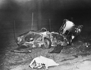 The wrecked remains of James Dean's Porsche 550 Spyder at the site of the accident. The 24-year-old film star was killed on the evening of September 30th when his car collided with a college student's automobile at an intersection 28 miles east of Paso Robles, California.