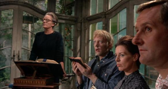 Mrs. Trefoile holds Sunday service at her home with her servants. (Bankhead, Donald Sutherland, Yootha Joyce, Peter Vaughan)