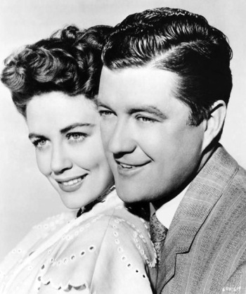 "Publicity photo of Dorothy Malone and Dennis Morgan for ""One Sunday Afternoon."""
