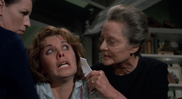 Mrs. Trefoile threatens to cut Patricia's face so she will no longer be attractive to men. Maid Kate holds Patricia so she can't escape.