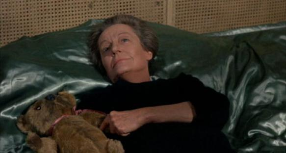 Mrs. Trefoile talks to her dead son while holding his Teddy bear.