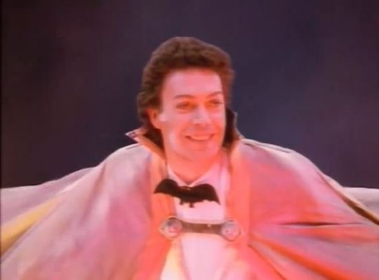 Tim Curry plays the Grand Wizard.