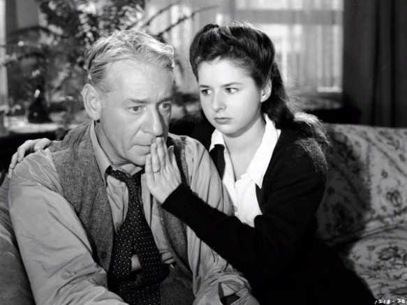 "Virginia Weidler with her father, played by Henry O'Neill, after he tried to commit suicide in ""Born to Sing."""