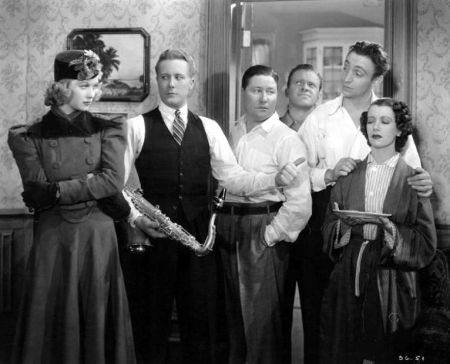 "Lucille Ball, Gene Raymond, Jack Oakie, Mischa Auer, Lily Pons and other band members in ""That Girl From Paris"""