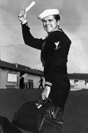 Jackie Cooper when he was discharged in 1946.  Original caption: Joyously waving his discharge paper, movie actor Jackie Cooper prepares to depart for Hollywood after leaving Navy separation center at Terminal Island, Long Beach. Cooper served 26 months and was discharged with rank of Musician, 3rd class.