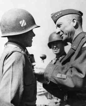 Murphy awarded for valor in 1945. Original caption: 1945-Europe: ANOTHER MEDAL FOR MOST DECORATED AMERICAN SOLDIER. General Alexander Patch of the U.S. 7th Army decorates Lt. Audie Murphy of Farmersville, Texas with the Medal of Honor.. Lt. Murphy is the most decorated American soldier, holder of every decoration for bravery save the legion of merit. He rose from the rank of private to become a company commander in 30 months of combat duty with the veteran third division.