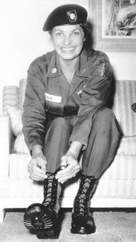 Martha Raye in Vietnam in her signature Green Beret and combat boots.