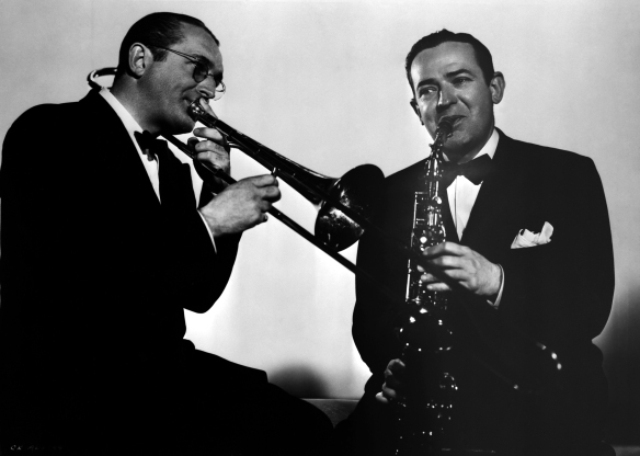 Tommy Dorsey playing the trombone and Jimmy Dorsey playing the saxophone.