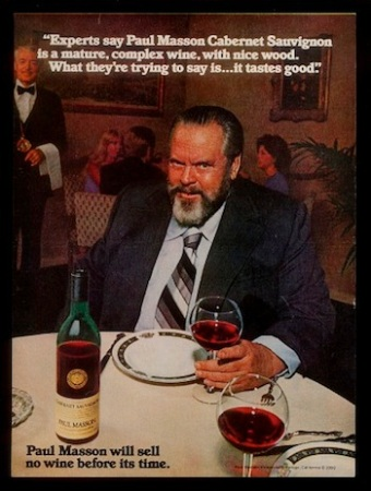 Welles in a printed Paul Masson advertisement.