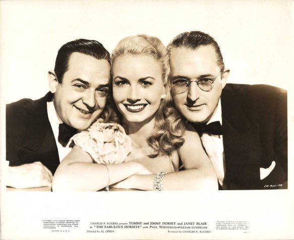 """Publicity photo of Jimmy Dorsey, Janet Blair and Tommy Dorsey for """"The Fabulous Dorseys"""" (1947)."""