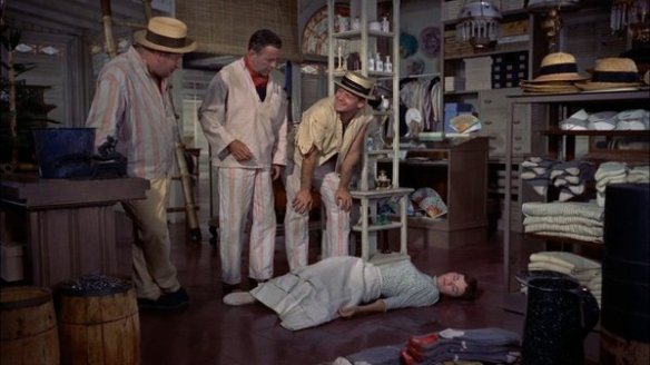 The convicts help Isabella after she faints.