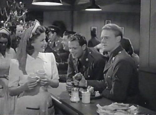 Pat (Jean Rogers) meets Mike (Van Johnson) at the canteen on Christmas Eve. (Comet Over Hollywood/Jessica P)