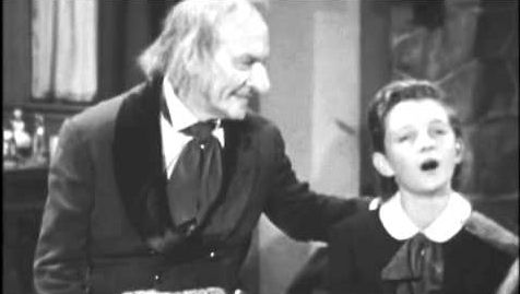 "Fredric March as Ebenezer Scrooge and Christopher Cook as Tiny Tim in a 1954 TV adaptation of ""A Christmas Carol"""