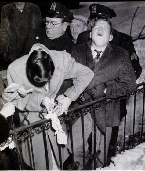 Joseph Gondola with his finger stuck on a fence. Photo by John Crivelli from the Patterson Evening News. (Scan by Comet Over Hollywood
