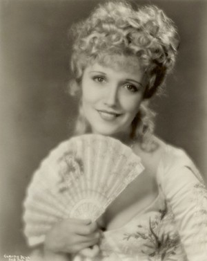 Publicity shot of Claudia Dell dressed in costume as Sweet Kitty Bellair
