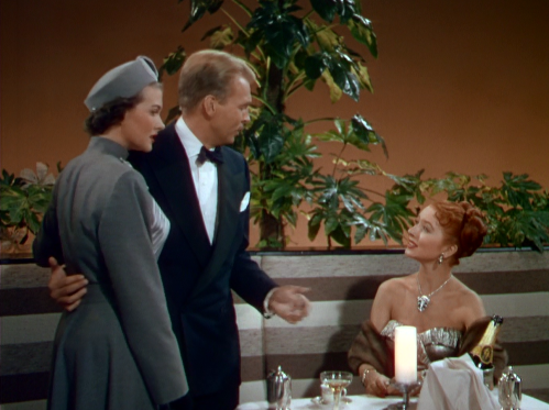 Paula Raymond helps John Lund escape Amanda Blake. (Comet  Over Hollywood screencap by Jessica P.)