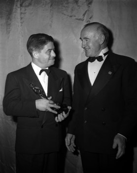 "Alfred Newman with Donald Crisp and his Academy Award for ""Mother Wore Tights."""