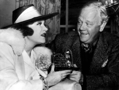 Alice Brady receives her Best Actress in a Supporting Role replacement award from Charles Winniger.