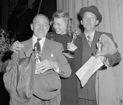 "Barry Fitzgerald (left), Ingrid Bergman and Bing Crosby (right) hold ""Oscars"" awarded them for outstanding performances in 1944. Fitzgerald was named best supporting actor for his role in Going My Way, in which picture Crosby's leading role won him best male actor award. Miss Bergman, best female actress, won top honors for her acting in Gaslight. Awards were made at Annual Motion Picture Academy"