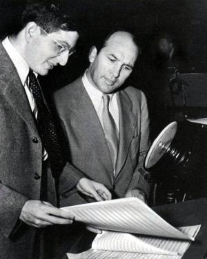 "Bernard Herrmann with director William Dieterle looking over the Academy Award winning ""All That Money Can Buy"" score."