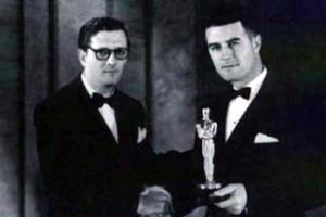 Douglas Shearer (r) at the 1935 Academy Awards dinner, March 1936, holding the award for sound recording for Naughty Marietta from presenter Hunt Stromberg