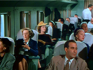 Susan Hayward as Jane Froman on a plane in 1943.