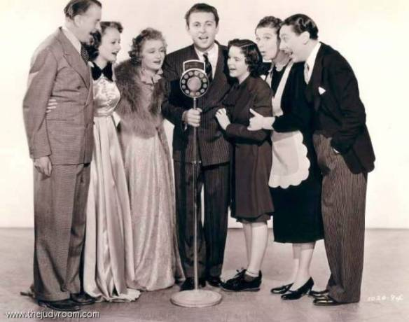 Everybody Sing publicity still with Reginald Owen, Lynne Carver, Billie Burke, Allan Jones, Judy Garland, Fanny Brice, Reginald Gardner