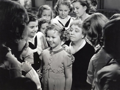 Shirley Temple and Jane Darwell, who runs the orphanage, preparing Shirley's character Betsy Brown to go live with her adoptive family.