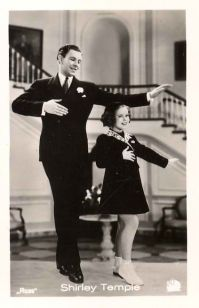 "George Murphy and Shirley Temple in ""Little Miss Broadway."""