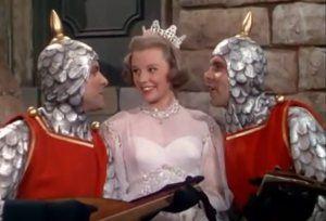 "June Allyson in the number ""Thou Swell"" with twins Ramon Blackburn and Royce Blackburn"