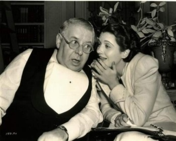 """S.Z. Sakall and Kay Francis on the set of """"It's a Date"""""""