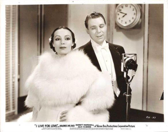 "Dolores Del Rio and Everett Marshall in ""I Live for Love."""