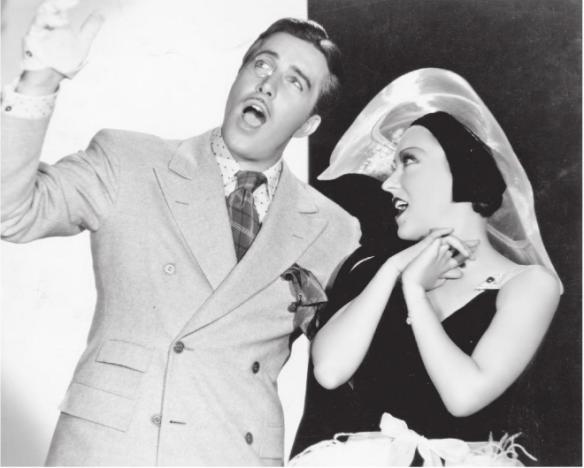 "John Boles and Gloria Swanson in ""Music in the Air"" (1934)."