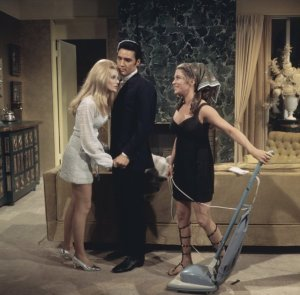 Bernice (Carey) won't leave Greg (Presley) alone. Also pictured, Celeste Yarnall.