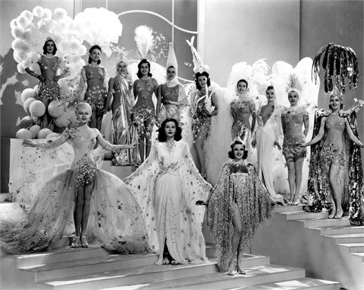 """Publicity still of the costumes from the """"You've Stepped Out of a Dream"""" number"""