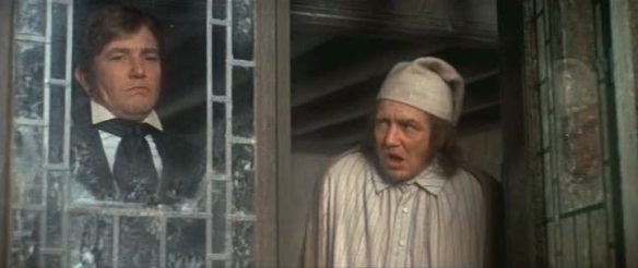 Young Scrooge with old Scrooge, both played by Albert Finney