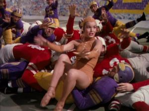 Debbie Reynolds dressed as a football, showing how much she is struggling in her dancing and acting career.