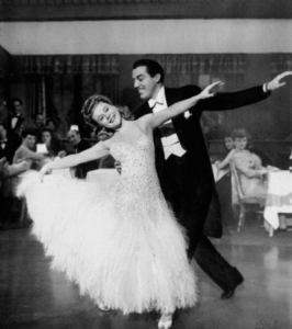 Sonja Henie doesn't quite fit into this ballroom dancing performance with Cesar Romero.