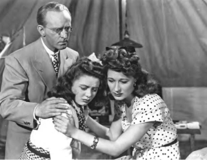Kay Kyser and Joan Davis comfort Marcy McGuire.